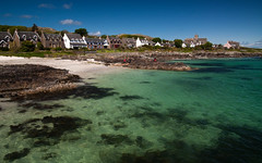 Iona Village Bay 1 (chris-parker) Tags: mull iona scotland beach rocks sand yacht sunset sea pinks seaweed sailing ship traigh ban boat rockpool puppy cal mac caledonian macbrayne