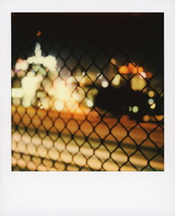 101 & Vine 3 (tobysx70) Tags: polaroid originals color sx70 instant film sx70sonar sonar 101 vine street hollywood los angeles la california ca bokeh outoffocus freeway el camino real traffic cityscape neon sign night nocturnal lighttrails city lights capitol records building knickerbocker chain link fence vanishing point motion blur toby hancock photography