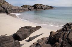 Beach nr Uisken 1 (chris-parker) Tags: mull iona scotland beach rocks sand yacht sunset sea pinks seaweed sailing ship traigh ban boat rockpool puppy cal mac caledonian macbrayne