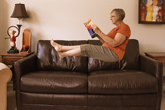 Reading Up on Exposure (lclower19) Tags: self levitation couch person 3352 522019 reading book odc seat