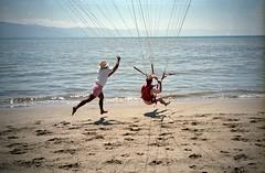 Parasailing (Crawford Brian) Tags: ocean sea sun film beach water analog mexico flying sand 1988 parasail pointandshoot puertovallarta