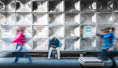 waiting at the Elephant and Castle (Jonathan Vowles) Tags: walk blur blurred seated