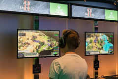 Games fair visitor plays the popular strategy game Age of Empires II: Definitive Edition on Xbox