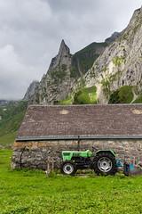 Farming in the alps (tom.leuzi) Tags: alpen alps berge ch canonef1635mmf4lisusm canoneos6d schweiz suisse switzerland mountains fählenalp fählensee alpstein appenzell appenzellinnerrhoden tractor traktor