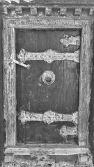 Ancient Wooden Door (AislinR) Tags: tibet blackandwhite bw wood door architecture monastery tashi lhunpo xigaze shigatse oldbuildings