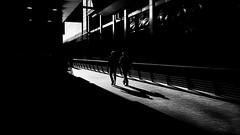 Into The Light (Sean Batten) Tags: london england unitedkingdom canarywharf eastlondon docklands streetphotography light shadow street ricohgr blackandwhite bw