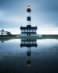 Haunted Light (Vladimir Grablev) Tags: outerbanks lighthouse usa landscape seashore water hatteras light summer atlantic ocean travel scenic reflection obx view bodieisland national northcarolina bluehours