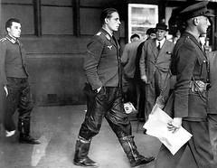 Under British military escort, two captured Luftwaffe crewmen. (CombatOfficiel) Tags: histoire history ww2 wwii 2gm britisharmy luftwaffe