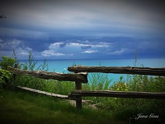 Beauty before the storm (janagoss32) Tags: lake clouds storm water wildflowers fence august2019 goderichontario lakehuron