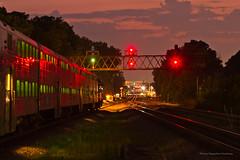 A Green Light Ahead (tim_1522) Tags: railroad railfanning rail illinois il unionpacific up geneva sub subdivision chicagonorthwestern cnw signalbridge sunset orange goldenhour tracks metra passenger commuter