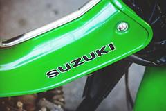 Vintage Suzuki in detail, Pt. II (Eric Flexyourhead) Tags: vancouver canada britishcolumbia bc ontariostreet themotosocialvancouver motorcycle motorbike bike japanese suzuki green vintage retro classic shallowdepthoffield sonyalphaa7 zeisssonnartfe55mmf18za zeiss 55mmf18