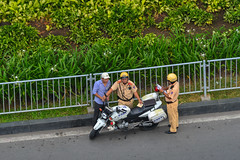 Traffic police on the road (phuong.sg@gmail.com) Tags: asia asian auto background cap car city control cop day driver employee enforcement fine guard hochiminhcity inspection inspector law male man motorcycle officer patrol people police policeman protection regulate road safety saigon security service standing street traffic transport transportation travel uniform urban vehicle vest vietnam work yellow