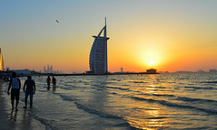 Burj Al Arab Hotel with the beach at sunset (phuong.sg@gmail.com) Tags: arabic arabian building beach architecture design asia dubai cityscape dusk architectural burjalarab holiday island hotel high gulf famous east emirates exotic expensive ocean red panorama modern landmark resort sail middle luxury jumeirah travel sunset sea summer sky tower tourism skyline skyscraper sand vacation water view united uae