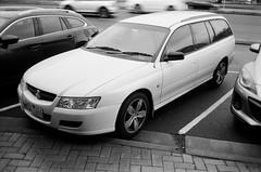 2007 Holden Commodore station wagon (Matthew Paul Argall) Tags: canonsnappy20 fixedfocus 35mmfilm kentmerepan100 100isofilm blackandwhite blackandwhitefilm car vehicle automobile transportation holdencommodore stationwagon