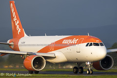 G-UZHR Airbus A320NEO Easyjet Glasgow airport EGPF 22.08-19 (rjonsen) Tags: plane airplane aircraft aviation airliner orange taxying morning light dark sky airside