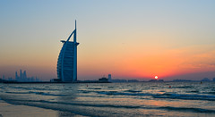 Burj Al Arab Hotel with the beach at sunset (phuong.sg@gmail.com) Tags: architectural arabic arabian building beach architecture design asia dubai cityscape dusk east burjalarab holiday island hotel high gulf famous landmark emirates exotic expensive jumeirah ocean red sea panorama modern sand resort sail middle luxury travel sunset summer sky tower tourism skyline skyscraper uae vacation water view united