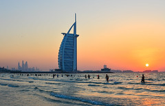 Burj Al Arab Hotel with the beach at sunset (phuong.sg@gmail.com) Tags: arabian arabic architectural architecture asia beach building burjalarab cityscape design dubai dusk east emirates exotic expensive famous gulf high holiday hotel island jumeirah landmark luxury middle modern ocean panorama red resort sail sand sea sky skyline skyscraper summer sunset tourism tower travel uae united vacation view water