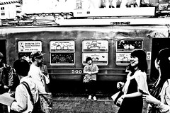 Alone in the city (Victor Borst) Tags: street trip travel urban blackandwhite bw travelling face asian real mono asia asians faces candid streetphotography streetlife traveling urbanjungle geel reallife realpeople urbanroots city monochrome japan demo japanese tokyo cityscape fuji expression expressions citylife monotone kawaii fujifilm shibuyacrossing hellokittty xpro2