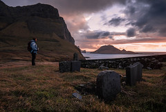 Woman standing in front of the old cemetery of Gasadalur during sunset - Faroe Islands (marcel.weber89) Tags: landscape mountain sky nature mountains faroeislands clouds hills travel sunset cemetery rock countryside green view hill blue winter grass cloud hiking sunrise beautiful wall cliffs sea water dawn dusk woman graveyard nordic outdoor seascape colourful vintage old melancholy valley gasadalur