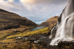 Water fall near the rural town of Saksun - Faroe Islands - Winter (marcel.weber89) Tags: landscape mountain sky mountains water lake nature clouds cloud blue river travel sea iceland scenery view rock rocks coast grass tourism winter peak valley bay saksun faroeislands rural old village town atlantic ocean sunset morning dawn cloudy hiking outdoor traveling vacation stream stones church waterfall