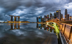 Stormy Morning (DanielKHC) Tags: jubilee bridge stormy clouds dramatic cbd centralbusinessdistrict cityscape nikon z7 ftz nikkor16mmfisheyef28 sunrise reflections dark long exposure singapore mbs marinabaysands