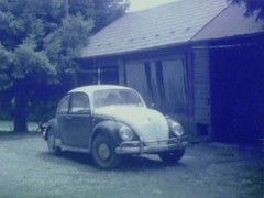 Kodak Star 110 Pocket Camera (NC Mountain Man) Tags: kodak 110film 1966 vw bug 1966vwbug volkswagon building garage car antique tree pine ncmountainman phixe lowresolutionversion film negative