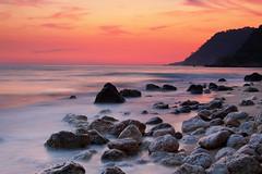 Sunset on Ionian sea (massonth) Tags: ionian sea seascape land sunset sky orange stones rocks waves canon eos60d 60d eos slow low greece epirus