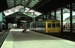 NOT THE CENTRE OF ATTENTION (Malvern Firebrand) Tags: dmu unit class101 metcam 2car blue awning station chester general cheshire trains railways br urban canopy platform transport vehicles 1977 23477 1970s