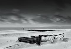 Beached Boats - Black and White (Anthony White) Tags: england unitedkingdom bournemouth durdlechine longexposure sand boat three 3 firecrest 10stopultra still seagull loneseagull dorsetuk dorset