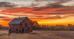 Beautiful Summer Sunset (http://fineartamerica.com/profiles/robert-bales.ht) Tags: facebook fineart flickr photouploads barn sunrise sunset house farm homestead ranch cattle barnwood fence butte squawbutte mountain idado landscape emmett idaho treasurevalley gemcounty scenicbiway americaphotography valley idahophotography beautiful sensational spectacular magnificent surreal sublime magical spiritual inspiring canonshooter haybales scenic wow stupendous superb building grass hay trees yellow blue robertbales sky railroad tracks panoramic pano