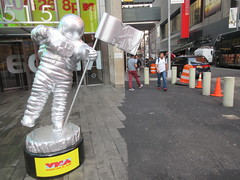 MTV Astronaut Award Guy Times Square NYC 8395 (Brechtbug) Tags: 2019 mtv awards silver styrofoam astronaut michelin man character guy hanging out times square new york city 08202019 nyc cable tv music television brand advertisement tire tires transportation balloon moon logo automotive flag advertising mascot cosmonaut spaceman space men helmet scifi science fiction moonman august summer