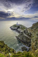 South Stack Lighthouse Cliff View, Anglesey, North Wales (Michael Long Landscaper) Tags: south stack lighthouse canon 1635mm holyhead sea coast wales landscape seascape ocean nature sky coastline sunset 5d landmark photo photograph island view uk rock rocks irish great britain isle blue waves welsh horizon long exposure shore wet gitzo benro rocky cloudscape outdoor travel dramatic cliff sun setting southstack northwales isleofanglesey holyisland goldenhour