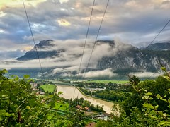 River Inn valley and cloud covered Zahmer Kaiser mountains seen from Thierberg, Tyrol, Austria (UweBKK (α 77 on )) Tags: river inn valley power line powerline electricity grid cloud rain grey sky zahmerkaiser zahmer kaiser mountain green tree forest tirol tyrol austria europe europa iphone österreich