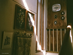 beam (markjwyatt) Tags: konicabigminihg guatemala city film analog fuji superia xtra 400 rail stairs light beam clock photographs paintings