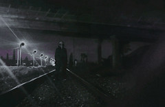 FOLLOWING. (PeachySick11) Tags: raven mask creepy edgy night scary fear follow following track bridge street road town train rails via tren puente afueras noche miedo susto syniester dark obscure surreal surrealista railes thing slender 7 pages frightening hideous monster ghost spectrum entity standing black
