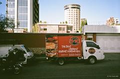 sandwiches (markjwyatt) Tags: konicabigminihg guatemala city film analog fuji superia xtra 400 truck sandwhiches english spanish 316 house buildings heliport