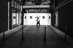 Street (lightersideofdark) Tags: blackwhite outside outdoors dark streetphotography scaffold alley people shadow