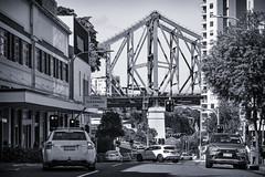 Story Bridge (hotpotato70) Tags: boundarystreet fortitudevalley brisbane queensland australia blackwhite monochrome silverefexpro2 tamron2470mmf28 canon7d bridge buildings apartments cars vehicles traffic road span sun structure lights street city