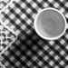 Waiting for an egg (OzzRod) Tags: pentax k50 leitzwetzlarhektor120mmf25 geometric pattern tablecloth eggcup squares monochrome blackandwhite dailyinaugust2019