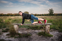 Having fun (Dannis van der Heiden) Tags: boy banc nature playing fun exercising trees grass forest sand sky clouds portrait people