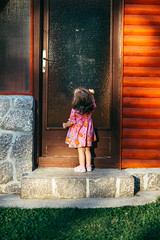 A little girl in a glamorous dress knocking on a vintage door (Ivan Radic) Tags: glass hand mädchen vintage alone andietürklopfen anticipation antique architecture asking baby beautiful brown building call child closed concepts curiosity curly cute decoration deisgn delivering detail discovery door doorknocker doorway dress entrance female gate girl glamour hair handle hope house klo knockingonadoor lifestyle little outdoors park retro window nikond610 sigma35mmf14dghsmart ivanradic