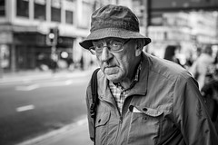 I'll Get My Hat (Leanne Boulton) Tags: urban street candid portrait portraiture closeup streetphotography candidstreetphotography candidportrait streetportrait eyecontact candideyecontact streetlife old elderly man male face eyes expression mood emotion feeling glasses hat booniehat tone texture detail depthoffield bokeh naturallight outdoor light shade city scene human life living humanity society culture lifestyle people canon canon5dmkiii 70mm ef2470mmf28liiusm black white blackwhite bw mono blackandwhite monochrome glasgow scotland uk