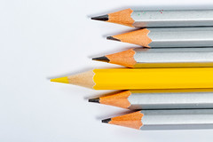Yellow pencil standing out from crowd of plenty identical grey fellows on white background (wuestenigel) Tags: education colored group art wooden closeup concept variation silvery drawing color background creative colour bright another standsout colorful draw grey pencil multicolor equipment special sharp crayon school yellow row white bildung schule bleistift creativity kreativität college hochschule noperson keineperson writing schreiben paper papier wood holz motley bunt composition zusammensetzung coloring färbung write rainbow regenbogen kunst stacks stapel kind nett farbe stilllife stillleben