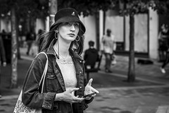 Decisions (Leanne Boulton) Tags: urban street candid portrait portraiture streetphotography candidstreetphotography candidportrait streetportrait streetlife woman female girl pretty face eyes expression emotion mood feeling atmosphere hat booniehat style fashion denim mobile phone smartphone technology tone texture detail depthoffield bokeh naturallight outdoor light shade city scene human life living humanity society culture lifestyle people canon canon5dmkiii 70mm ef2470mmf28liiusm black white blackwhite bw mono blackandwhite monochrome glasgow scotland uk