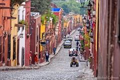 The Streets of San Miguel (in explore) (Michael Guttman) Tags: sanmigueldeallende streetscene street cobblestones cobblestonestreet buildings colonial colonialarchitecture architecture mexico centralmexico colorfulbuildings