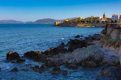 I primi raggi di sole sui bastioni... (giobertaskin) Tags: canon sardinia sardegna algher alghero sea mare bastioni raggi sun sole