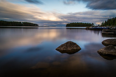 Cold water (mabuli90) Tags: finland lake landscape nature water rock longexposure boat dock sky clouds night