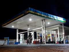 Kigali petrol station (Keith Tomlins) Tags: rwanda fillingstation motorbike night petrol kigali