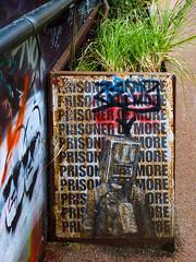Prisoner of More (Steve Taylor (Photography)) Tags: label tag prisonerofmore radiogram streetart pasteup wheatup wheatpaste stencil rust man men uk gb england greatbritain unitedkingdom london grass sunglasses sunnies twins gangsters