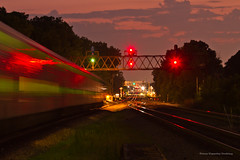 Metra UP West Line - River  Forest (tim_1522) Tags: railroad railfanning rail illinois il unionpacific up geneva sub subdivision signalbridge cnw chicagonorthwestern metra passenger commuter sunset goldenhour orange motionblur